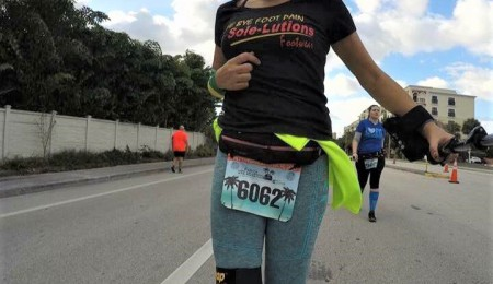Woman running marathon in Press Wrap gear