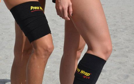 Two people wearing Press Wrap bandages on their thigh and calf