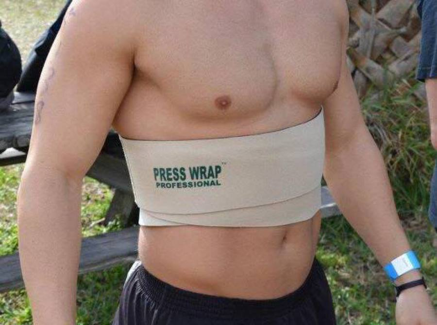 Press Wrap protecting person's abdomen