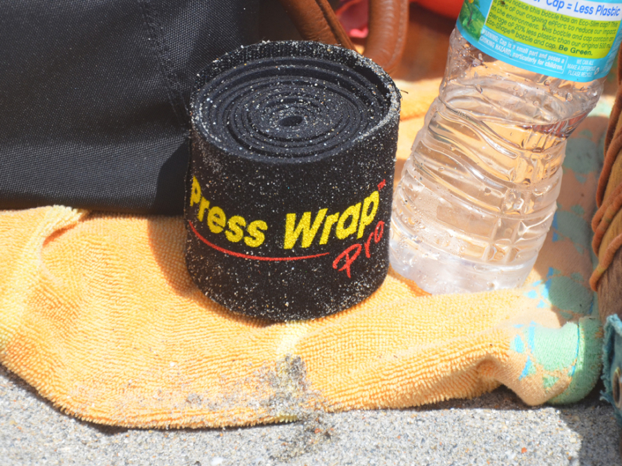 Black Press Wrap rolled up on beach
