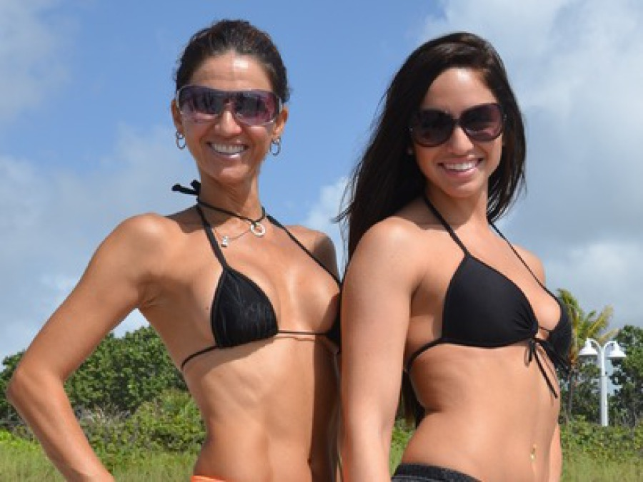 Two women wearing Press Wrap gear while at the beach